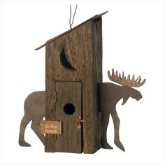 "Moose Hut Birdhouse Rough, rustic and utterly adorable, this crafty birdhouse is a country charmer indeed! Cunningly fashioned to resemble an old-fashioned outhouse, with a metal-cutout moose standing guard. Weight 0.9 lb. Wood and sheet metal. 9"" x 3 1/4"" x 10"" high."