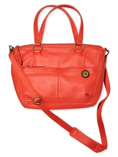 A crossbody bag in a fiery cayenne hue energizes neutrals ($104, The Sak).