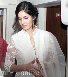 Katrina Kaif recently wearing a chic salwar kameez mesmerizing sheer minimalism on display. The pristine white outfit, the intricate chikan embroidery work and the effortlessness with which Kat carries herself spells unbeatable sophistication. Indian Celebrities, Bollywood Celebrities, Bollywood Actress, Bollywood Stars, Bollywood Fashion, Beautiful Indian Actress, Beautiful Actresses, Indian Dresses, Indian Outfits