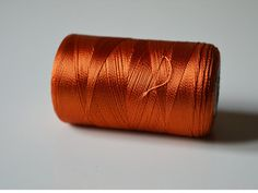 Dark Orange Color spool of art silk thread approximately above 500 yards (23 g). This art silk thread is of premium quality is perfect for hand and machine embroidery. These can be used for craft purpose such as Tassels, Pompom, Jewelry Making, Hand worked buttonholes, Decorative Stitching, Applique, Micro-stippling, Sewing, Quilting, fly rod wrapping and fly tying. Make beautiful embroidery patterns using them. Sh / 62-D  If you want any specific colours please convo me I will try my best…