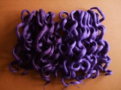 Curly wool dreads.