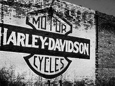Awesome painting of the Bar and Shield on brick. #HarleyDavidson