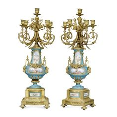 A pair of five branch ormolu and Sevres style porcelain candelabra, 19th century, France