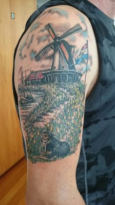 Black and grey sleeve with colours highlighting the tattoo. The path is an outline of New Zealand, which is home for me now.