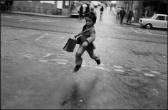 Josef Koudelka (little schoolboy running - Lisbon 1975)