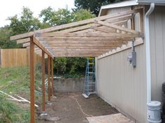 patio off of the garage pictures | TRUSSES FROM THE BACK - You can see the use of more ledger board ...