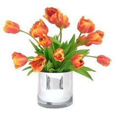 "Faux tulip arrangement in silver vase.  Product: Faux floral arrangementConstruction Material: Silk and glassColor: Orange and silverFeatures: Includes faux tulipsDimensions: 21"" H x 21"" W"