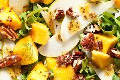 Pear Papaya arugula salad with lime mustard vinaigrette