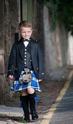 Boy dressed in classically tailored Prince Charlie kilt by ScotWeb Tartan Mill, Scotland.
