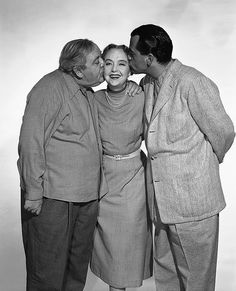 Lillian Gish gets a birthday kiss from The Night of the Hunter director Charles Laughton and producer Paul Gregory.