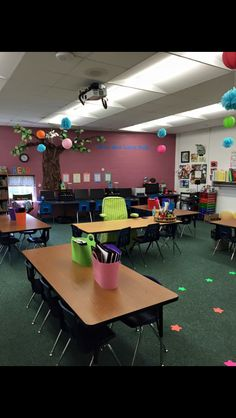 First grade classroom set up. Teacher table in the center. Tables vs. desks.