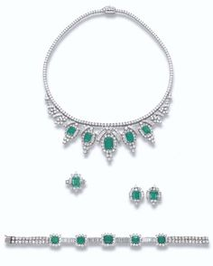 PROPERTY OF A ROYAL HOUSE: AN EMERALD AND DIAMOND SUITE The fringe necklace designed with five graduated rectangular-shaped emeralds within a brilliant-cut diamond cluster surround to the baguette and brilliant-cut diamond detail suspended from a brilliant-cut diamond line, bracelet, earrings and ring en suite.