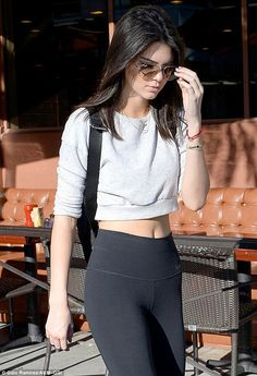 Revealing lunch: Kendall Jenner exited a Beverly Hills deli alone on Monday, showing off her toned figure in a midriff-baring top