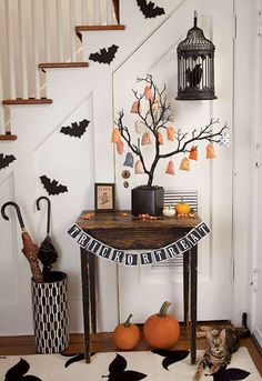 Design your house in the perfect Halloween décor with the Halloween tree, bats, pumpkins and even your own cat with this ensemble as reference. You can even add Halloween themed rugs to match the occasion.