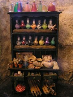 Potions Cupboard in miniature by Oberonswood on Etsy~ I know someone who'd love this!) Potions Cupboard in miniature by Oberonswood on Etsy~ I know someone who'd love this! Haunted Dollhouse, Haunted Dolls, Dollhouse Miniatures, Halloween Miniatures, Bottle Charms, Witch House, Witch Cottage, Mini Things, Miniture Things