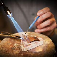 goldsmith making a custom gold ring