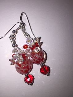 Absolutely gorgeous!  This pair of earrings was created using gorgeous hand crafted lampwork Lotus Blossom glass beads, accented with