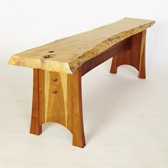 Natural-edge bench with a box-elder slab seat on a cherry base