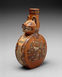 Feline Bottle    Date:      8th–10th century  Geography:      Peru  Culture:      Wari  Medium:      Ceramic  Dimensions:      H. 8 x W. 4 1/2 x D. 2 1/2 in. (20.32 x 11.4 x 6.4 cm)  Classification:      Ceramics-Containers