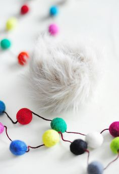 These faux fur bag poms are just the cutest and so simple to make... And they're cute hanging from anything, including holiday gift wrapping! Click through the photo for a full DIY tutorial!