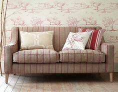 Sofa upholstered in Vanessa Arbuthnott's 'Nordic Stripe' - Reindeer / Raspberry