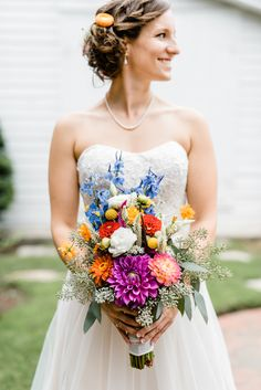 David's Bridal bride Rebecca in a strapless sweetheart wedding dress with a beaded lace bodice and tulle skirt for her organic, sparkly and colorful wedding.