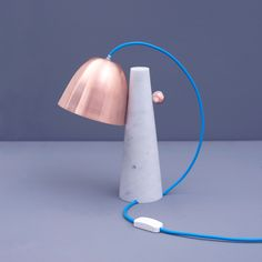 'clochette' is a table lamp with copper lampshade that is attached to a white marble pedestal | zpstudio tools works with artisans in italy to design handcrafted collection