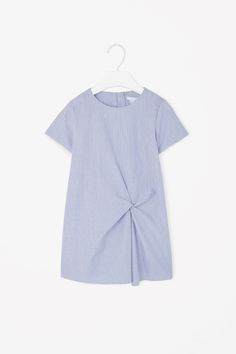 For my lovely god child! This dress is made from lightweight cotton chambray with a striped pattern and gathered knot detail on the front. A flared, A-line shape, it has a simple round neckline, short sleeves and subtle in-seam side pockets. Cute Outfits For School, Kids Outfits, Bitty Baby Clothes, Patron Vintage, Kid Styles, Dress Skirt, Knot Dress, Apparel Design, Winter Dresses