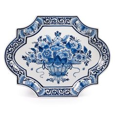"""Entirely handpainted in Holland in the same workshop in production since the 17th century. Classic blue and white color palettes with flower and leaf motifs. Exclusively at Scully & Scully.     Measures 11 ⅞"""" w x 9 ⅛"""" d x ¾"""" h."""