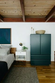 wardrobes in the green of the record cabinet and bathroom vanity