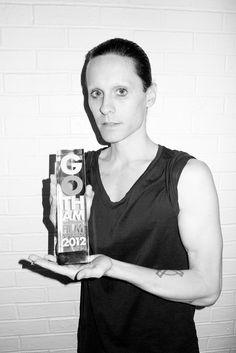 Jared Leto holding the Gotham award he just won.