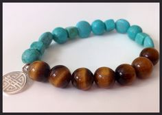 A bracelet to wish Happiness!  Gemstone bracelet made of Tiger Eye and turquoise imitation and a pendant with the chinese character of double happiness. For more styles and jewelry look us in facebook: B4U, designed by Roxana E. Balmes.