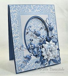 Love this card using spellbinder's ovals for frames and foliage die cuts!