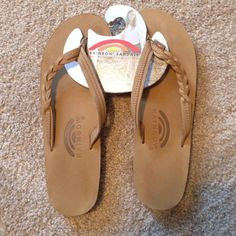 f1c187fbed19 Shop Women s Rainbow size Sandals at a discounted price at Poshmark.  Description  BRAND NEW Rainbow Leather Flip Flop Sandals  Braided Strap  MEDIUM FITS ...