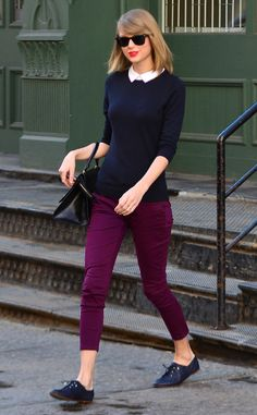 Taylor Swift sports a stylish navy blue sweater, white blouse and maroon pants while out and about in NYC.