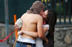Anti-government protesters kiss during a protest against Venezuelas President Nicolas Maduros government in Caracas March 22, 2014. Two Venezuelans died from gunshot wounds during protests against Maduro, witnesses and local media said on Saturday, pushing the death toll from almost two months of anti-government protests to 33. REUTERS/Christian Veron (VENEZUELA - Tags: CIVIL UNREST POLITICS TPX IMAGES OF THE DAY)