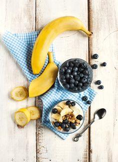 Yogurt with homemade granola banana and blueberries.