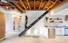 Exposed basement ceiling lighting ideas staircase industrial with natural wood steel stair Exposed Basement Ceiling, Basement Ceiling Insulation, Basement Ceiling Options, Basement Lighting, Open Ceiling, Ceiling Lighting, Ceiling Ideas, Basement Ideas, Gym Lighting