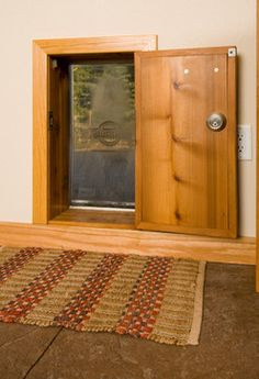 """""""dog Door"""" Design Ideas, Pictures, Remodel, and Decor - page 6 - perfect built in dog door with lock."""