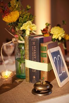 Harry potter included in the book centerpieces ; Wedding Book, Wedding Table, Fall Wedding, Our Wedding, Library Wedding, Wedding Story, Wedding Themes, Wedding Decorations, Table Decorations