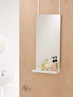 Shelf + Mirror: Over-The-Door Mirror from Urban Outfitters. This mirror, with a shelf that's just right for holding your out-the-door essentials, is perfect if you're not allowed to make holes in your apartment walls.
