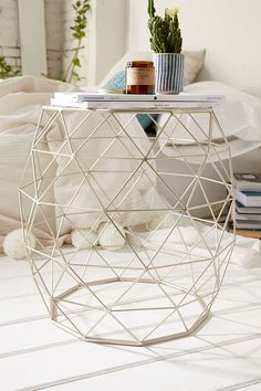 Living room- side table for the sofa and cow chair. This would go in the corner of the room where the recliner currently is. Couch on one side, cow chair on the other. Geometric Metal Side Table - Urban Outfitters