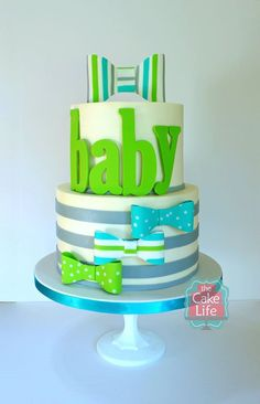 green and blue baby shower cake with bowties and stripes