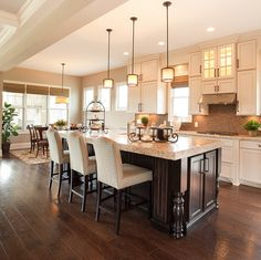 Kitchen bar seating inside the new custom model home by Wedgewood Building Company at Grandin Hall in Carmel, Ind.