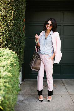 You can be girly and professional in a sharp pink suit. Wear a chambray top for a more casual look or a nice dress shirt/blouse for a more business look.