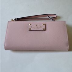 NWT Kate Spade Wellesley Layton Tech Savvy Wallet NWT Kate Spade Layton Wellesley Tech savvy wallet / Wristlet in posy pink. Plenty of room for all your cards, cash and phone!  No trades kate spade Bags Clutches & Wristlets
