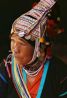 The area around Chiang Mai is home to the country's numerous ethnic minorities. This Akha woman wears a traditional headdress.