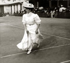 1900s - Not so much as an ankle in sight, the ladies who played tennis at the turn of the century were cinched in corsets and belts, and covered up in floor-grazing skirts, hats, and long sleeves.