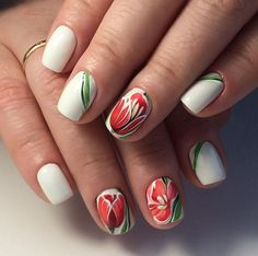 These Simple Spring Nails. If you want something simple yet amazingly themed with spring, then this nail art design is worth considering, that is equipped with the amazing play of colors and deep details. The growing red tulips on alternate nails with white base and green stems is simply wow!