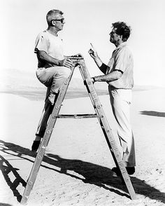 Rare behind the scenes of filmmaker Richard Brooks (left) talking to actor Burt Lancaster (right) on the desert set (just outside of Las Vegas) of The Professionals (1966). Burt Lancaster originally thought he was going to play the lead role of the film that eventually went to Lee Marvin.